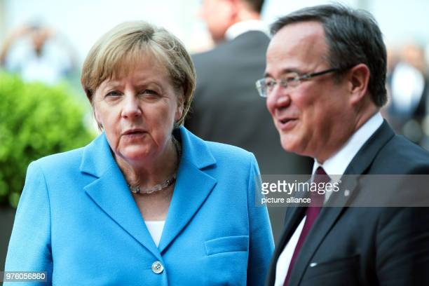 Premier of North RhineWestphalia Armin Laschet of the Christian Democratic Union greets Chancellor Angela Merkel in front of the State Chancellery 25...