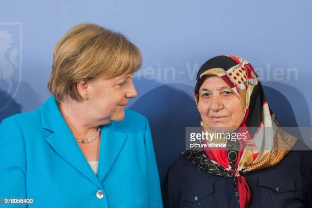 May 2018, Germany, Duesseldorf: The German Chancellor Angela Merkel of the Christian Democratic Union standing beside Mevlude Genc , mother,...