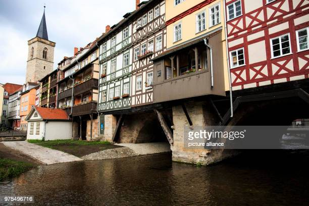 May 2018, Germany, Erfurt: The river Gera passes under the Kraemerbruecke. The Kraemerbruecke is the largest conglomeration of houses built on any...