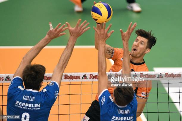 Volleyball men bundesliga final VfB Friedrichshafen vs Berlin Volleys in the ZF arena Berlin's Adam White trying to belt the ball over the net whilst...