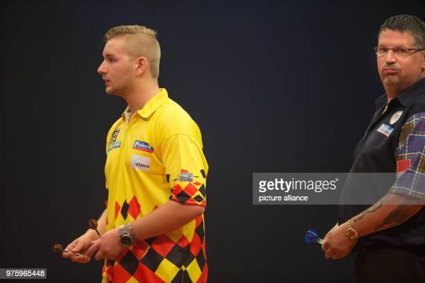 Scottish darts player Gary Anderson and Belgian darts player Dimitri Van den Bergh at the German Darts Masters 2018 of the PDC World Series Photo...