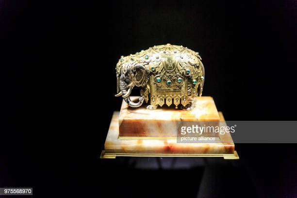 May 2018, Germany, Gotha: An elephant set with emeralds and diamonds, partly gilded is on display in a glass cabinet at Friedenstein Palace....
