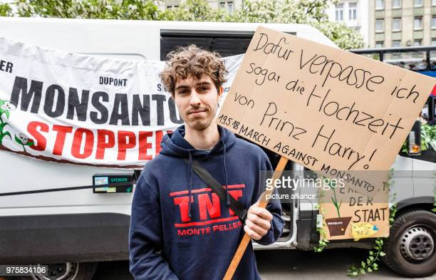 A protestor carries a sign reading 'Dafuer verpasse ich sogar die Hochzeit von Prinz Harry' on the worldwide campaign day against the agricultural...