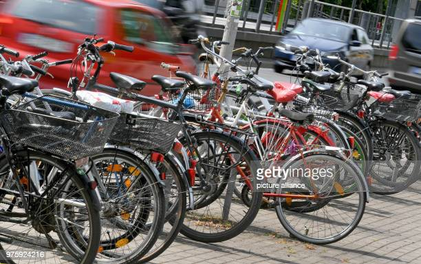 May 2018, Germany, Hanover: Bikes locked up at metal stands in the inner city. Photo: Holger Hollemann/dpa
