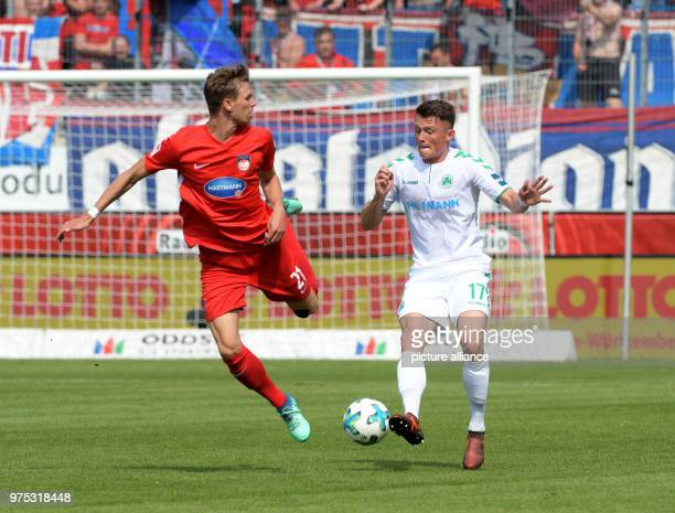 Soccer 2 Bundesliga 1 FC Heidenheim vs SpVgg Greuther Fuerth at the VoithArena Heidenheim's Maximilian Thiel and Fuerth's Fabian Reese Photo Stefan...