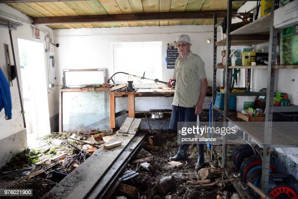 Ulrich Schaefer standing in his flooddamaged garage after flooding in Herrstein Photo Harald Tittel/dpa