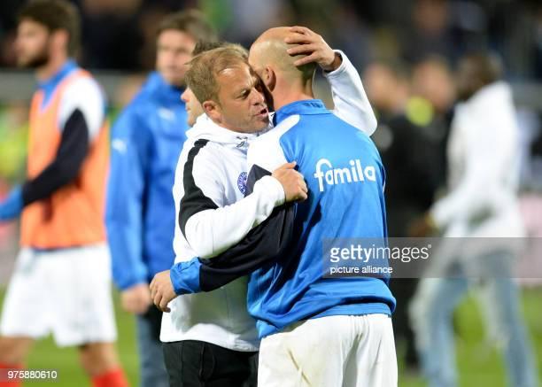 Soccer Bundesliga Descent Holstein Kiel vs VfL Wolfsburg return match in the Holstein Stadium Kiel's coach Markus Anfang hugs Kiel's Patrick Herrmann...