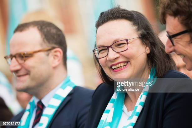 Minister for health from the Christian Democratic Union Jens Spahn and leader of the Social Democratic Party Andrea Nahles taking part in a service...
