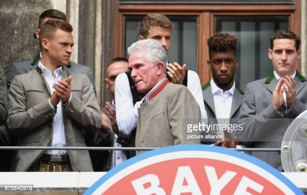FC Bayern Munich's Joshua Kimmich Thomas Mueller Kingsley Coman and Sebastian Rudy applaud outgoing coach Jupp Heynckeson on the balcony of city...