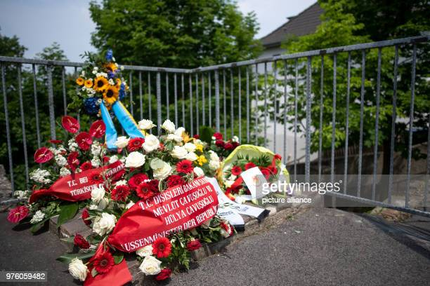 Flowers are placed at the site of the arson attack the former home of the Genc family 25 years after the racially motivated arson attack of Solingen...
