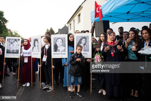 Mevlude Genc and her granddaughter Ozlem Genc participate in a prayer at the place of the arson attack 25 years after the racially motivated arson...