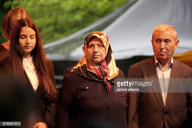 Mevlude Genc her granddaughter Ozlem Genc and her husband Durmus participate in the minute's silence during the memorial event for the arson attack...