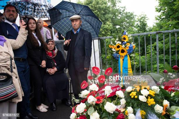 Mevlude Genc her granddaughter Ozlem Genc and her husband Durmus participate in the memorial event for the arson attack of Solingen 25 years after...