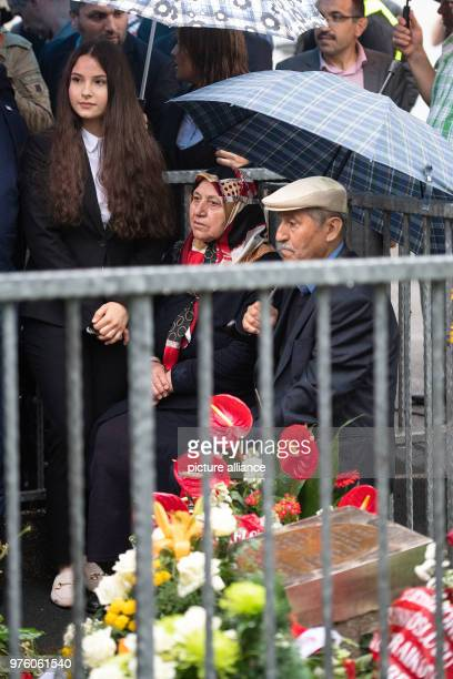 Mevlude Genc her granddaughter Ozlem Genc and her husband Durmus participate in the memorial event for the arson attack of Solingen at the place of...