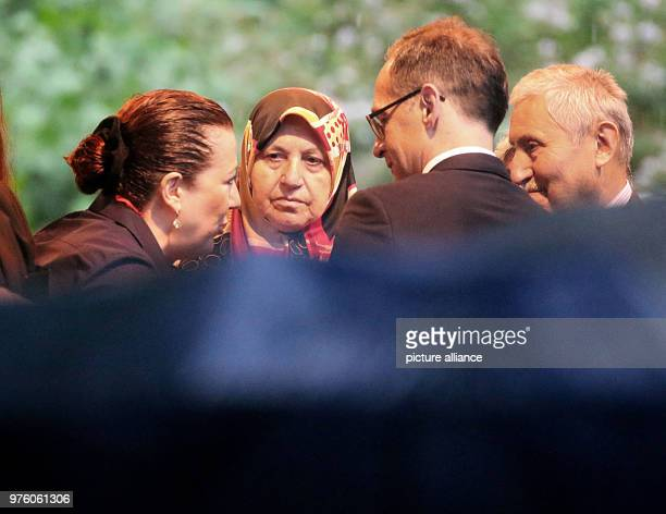 Mevlude Genc speaks with German Foreign Minister Heiko Maas at the memorial event for the arson attack of Solingen after the cancellation of the...