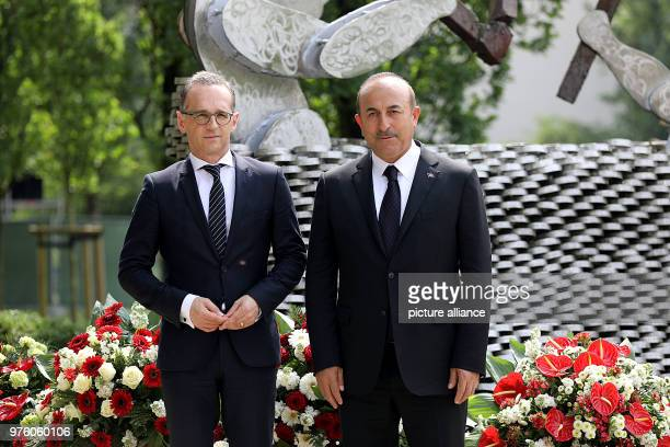 Mevlut Cavusoglu Turkey's Minister of Foreign Affairs and German Foreign Minister Heiko Maas visit the memorial for the victims of the arson attack...