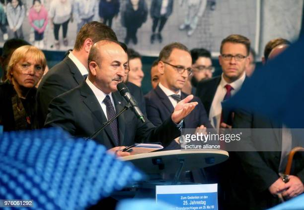 Mevlut Cavusoglu Turkey's Minister of Foreign Affairs speaks to the visitors after the cancellation of the memorial event next to German Foreign...