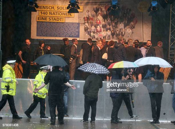 Police officers clear the memorial event for the arson attack of Solingen The event had to be cancelled due to a storm 25 years after the racially...