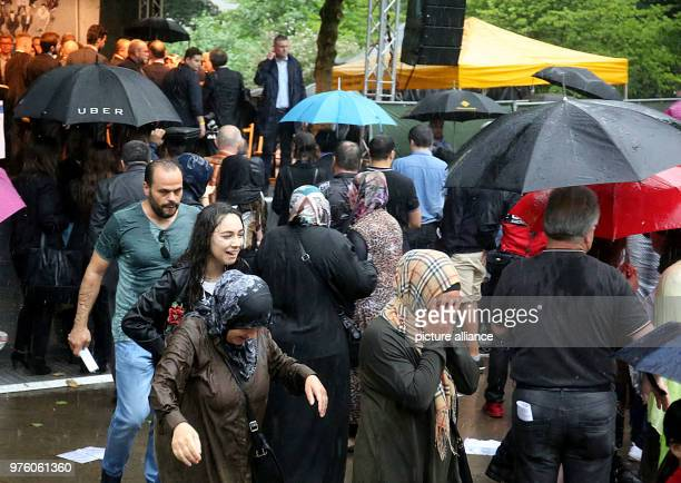 Visitors leave the memorial event for the arson attack of Solingen The event had to be cancelled due to a storm 25 years after the racially motivated...
