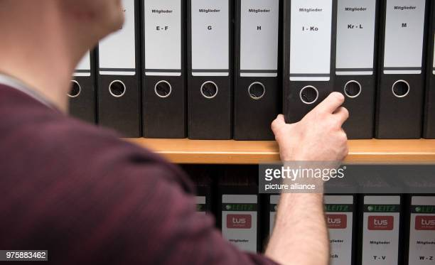 A man takes a folders withmembership applications of the sports club TUS Stuttgart out of a shelf The new EU data protection regulation will be...