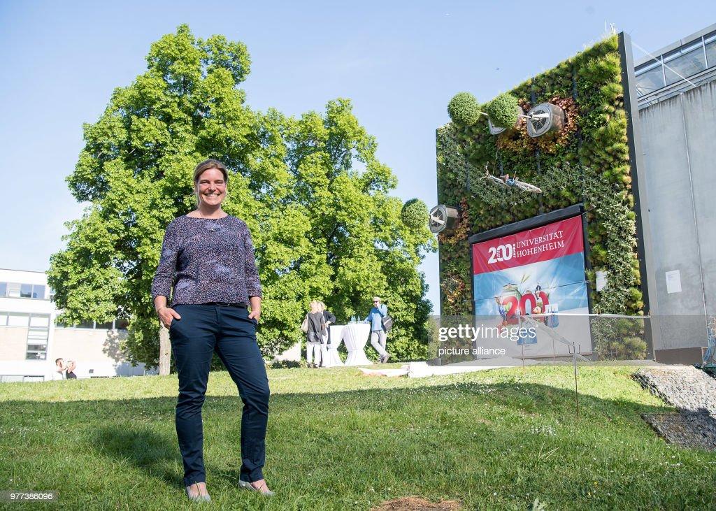 Alina Schick, Manager Of The Visioverdis Startup, Standing Before Uni  Hohenheimu0027s Vertical Hightech Garden