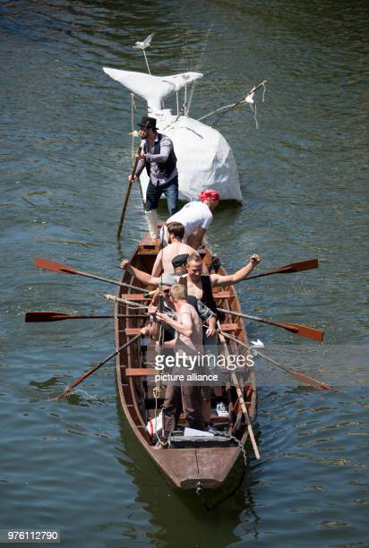 A Moby Dickthemed decorated punt on the river Neckar during the 63rd Stocherkahnrennen Photo Sebastian Gollnow/dpa