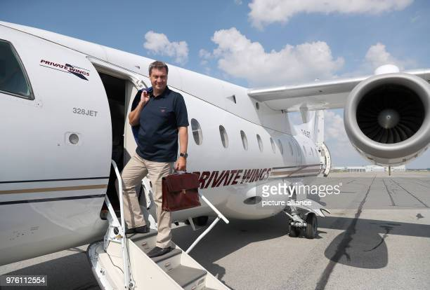 Markus Soeder premier of Bavaria pictured on the steps of a plane before flying at the airport in Munich Soeder is set to meet the Pope in the...