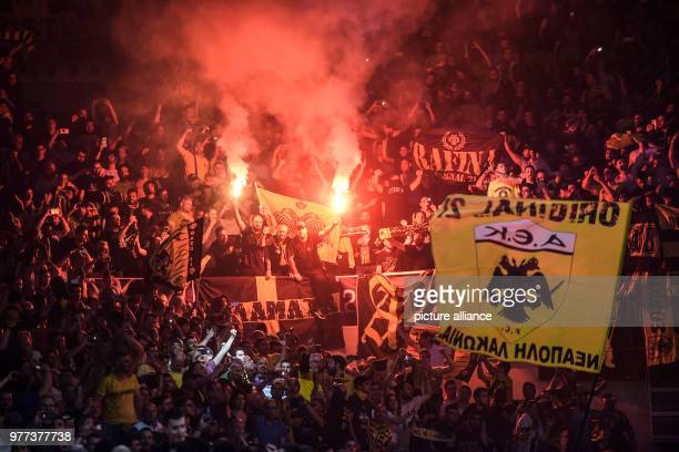 Basketball Champions League AS Monaco vs AEK Athens Final Athens' fans celebrate and ignite fireworks after the match Photo Angelos Tzortzinis/dpa