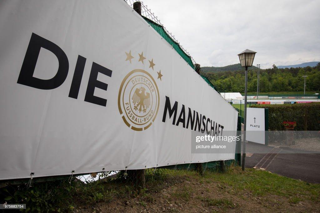 A Sight Fence With Banner Reads The Mannschaft Lit Team