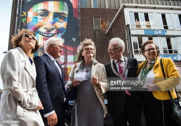 German President FrankWalter Steinmeier and his wife Elke Bueedenbender viewing the former NDSMwharf with borough mayor Coby van Berkum acting mayor...
