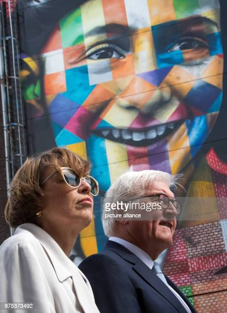 German President FrankWalter Steinmeier and his wife Elke Bueedenbender viewing the former NDSMwharf in front of a house with an image of Anne Frank...