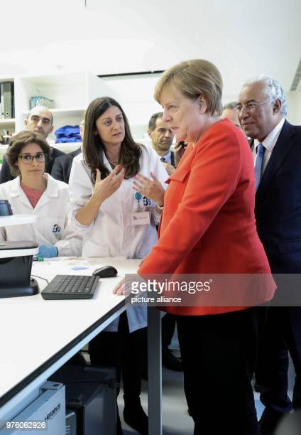 German Chancellor Angela Merkel and Portugese President António Costa speaking to students at the institute for health research and innovation at the...