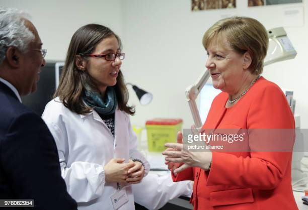 German Chancellor Angela Merkel and Portugese President António Costa visiting the institute for health research and innovation at the University of...