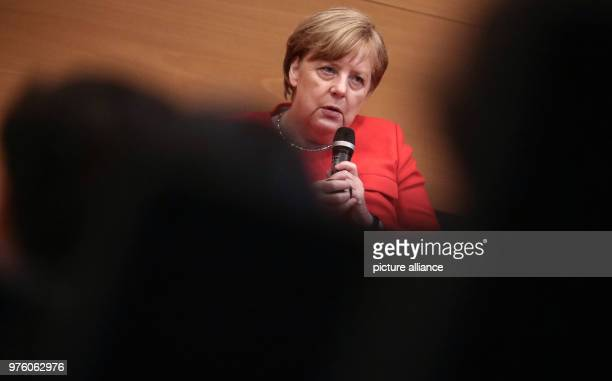 German Chancellor Angela Merkel speaking with students at the citizens dialogue for the future of Europe at the institute for health research and...