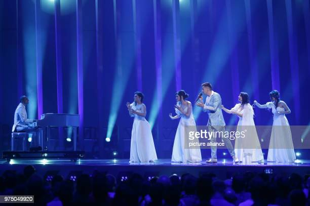 Montenegro's Vanja Radovanovic standing on the stage during the second dress rehearsal of the second semi final at the Eurovision Song Contest The...