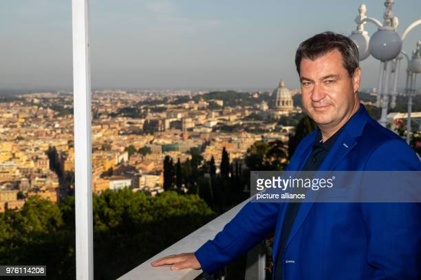 Markus Soeder premier of Bavaria with Rome and the dome of St Peter's Basilica in the background Photo Daniel Karmann/dpa