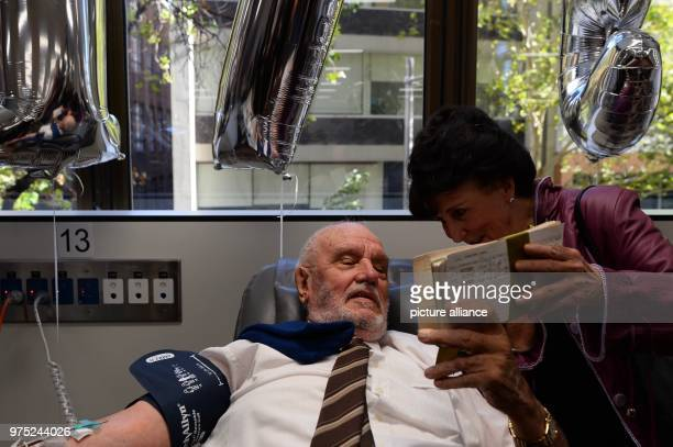 Robin Barlow the former director of the blood donor service of the Australian RedCross shows James Harrison the documents of his first blood...