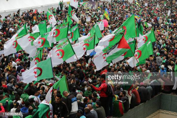 May 2019, Algeria, Algiers: Algerian protesters hold flags as they take part in an anti-government demonstration for an 11th consecutive Friday,...