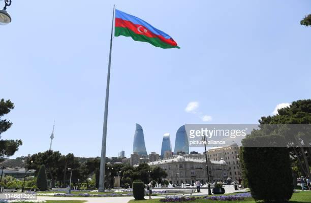 May 2019, Azerbaijan, Baku: The national flag of Azerbaijan is flying in the Milli Park near the old town of Baku. The capital of Azerbaijan is...