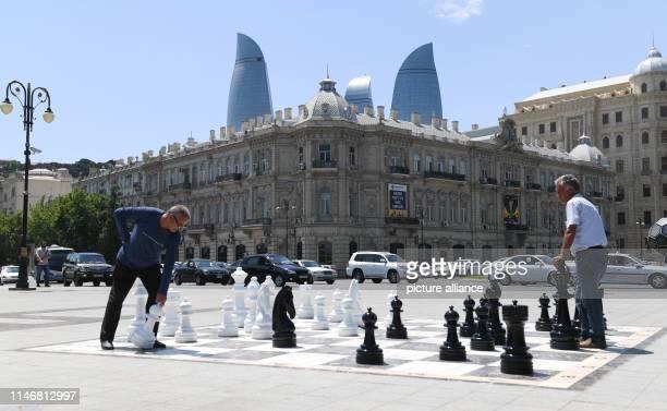 May 2019, Azerbaijan, Baku: Two men play chess at Azneft Square near the old town of Baku. The capital of Azerbaijan is located on the Caspian Sea...