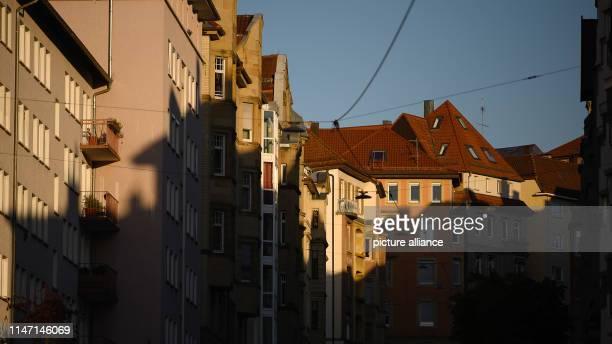 15 May 2019 BadenWuerttemberg Stuttgart Houses are lit by the morning sun Photo Sebastian Gollnow/dpa