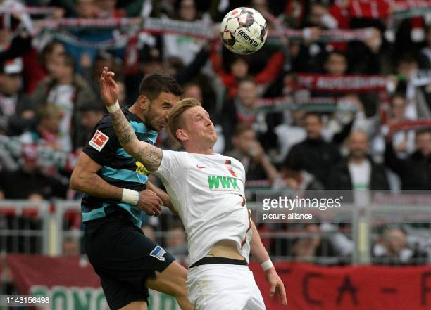 Soccer Bundesliga FC Augsburg Hertha BSC 33rd matchday in the WWKArena Andre Hahn from Augsburg and Marko Grujic from Berlin are in a header duel...