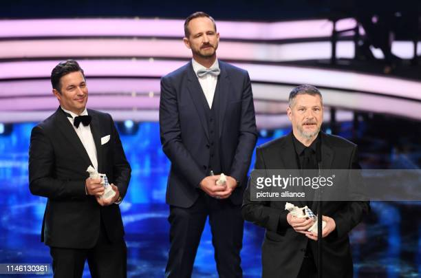 Oliver Vogel producer Marcus Ammon media manager and Andreas Prochaska director receive the trophy the Blue Panther at the Bavarian Television Award...