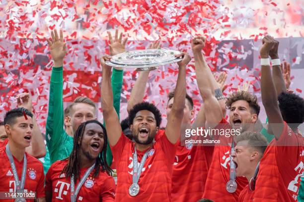 Soccer Bundesliga Bayern Munich Eintracht Frankfurt 34th matchday in the Allianz Arena Serge Gnabry from Munich cheers with the championship cup at...