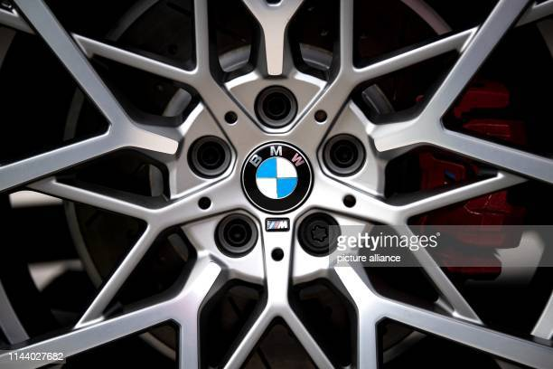 The logo of the Munich car manufacturer BMW can be seen on the rims of a car BMW shareholders will meet for the Annual General Meeting on 16 May 2019...