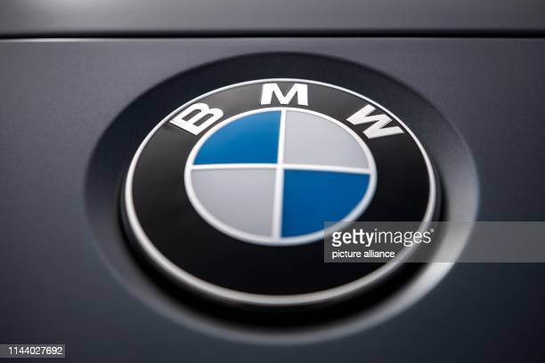 The logo of the Munich car manufacturer BMW can be seen on a car BMW shareholders will meet for the Annual General Meeting on 16 May 2019 in Munich's...
