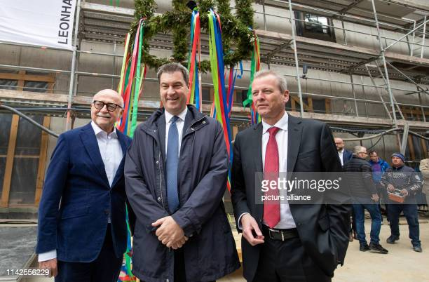 Gerd Schmelzer building contractor from Nuremberg Markus Söder Minister President of Bavaria and Ulrich Maly Lord Mayor of Nuremberg stand in front...