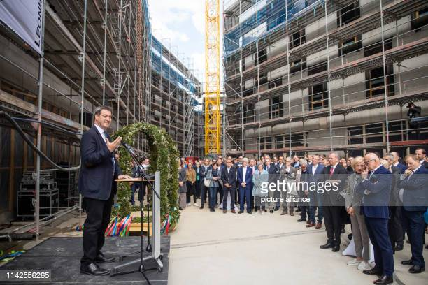 Markus Söder Prime Minister of Bavaria speaks at the toppingout ceremony for the Augustinerhof with the branch of the Deutsches Museum in front of...