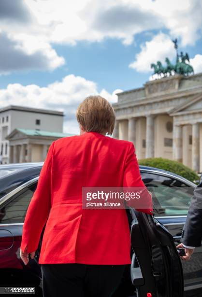 """Chancellor Angela Merkel gets into her car after her speech at the celebration """"10 Years Generation Bridge Germany"""" in front of the Brandenburg Gate...."""