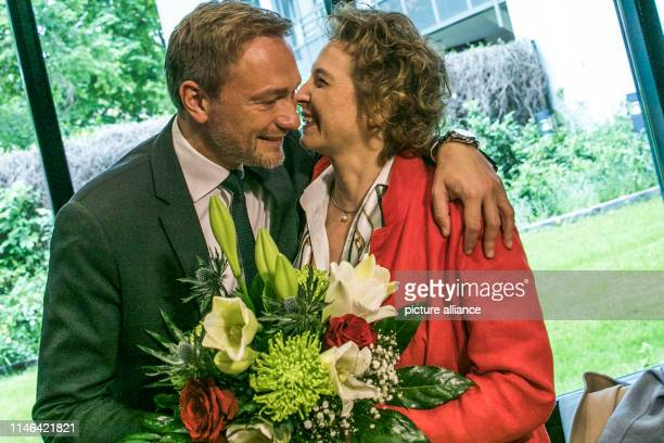 Christian Lindner, Federal Chairman of the FDP, hands flowers to Nicola Beer, the FDP's top candidate in the European elections, before the committee...